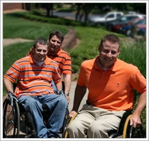 Chris Malcom [back] and his friends, Eric and David, understand the importance of choosing the right wheelchair cushion.
