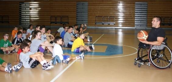 Ryan speaking to kids at a basketball camp