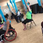 Adaptive Aerial Yoga Allows Wheelchair Users to Fly