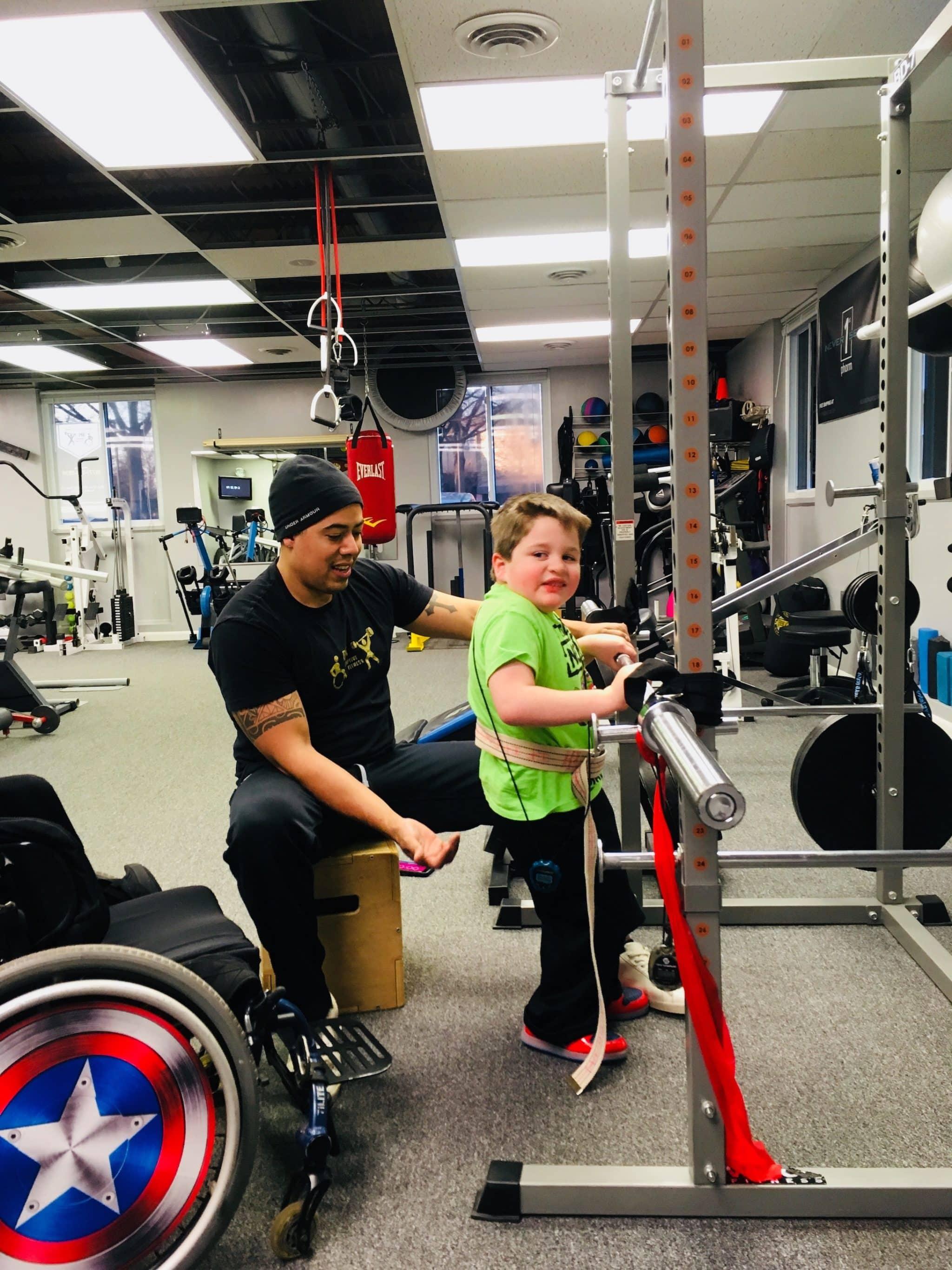 Devon-boy-wheelchair-lifting-weights