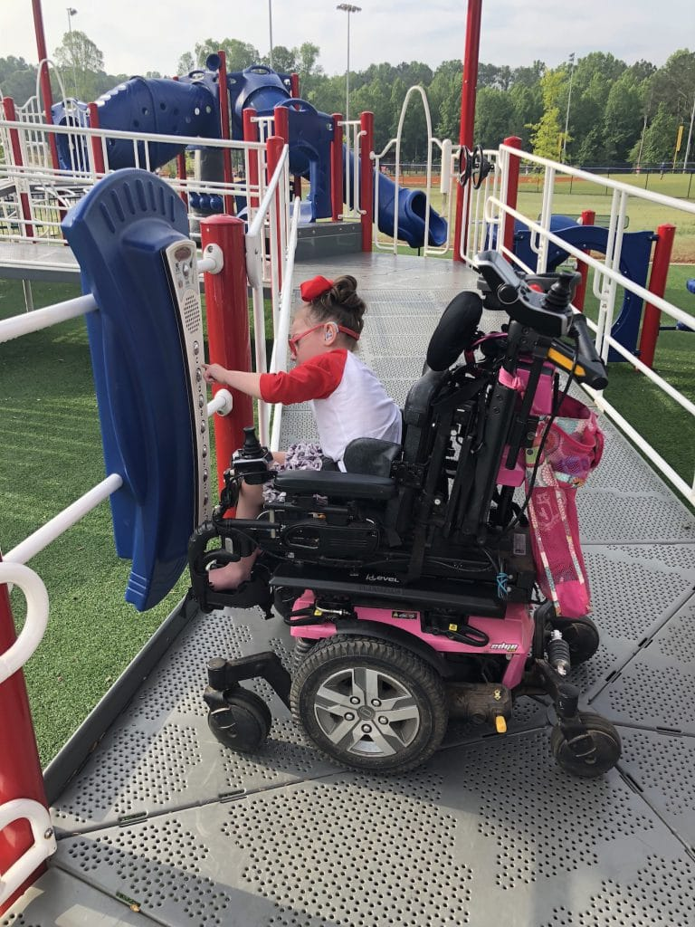 Kessley in power wheelchair