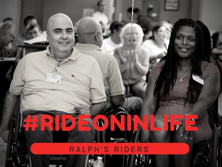 Ray Pizarro and Marcy Lovett sitting in their wheelchairs with their backs to a mirror. #RideOnInLife is in bold red letters.