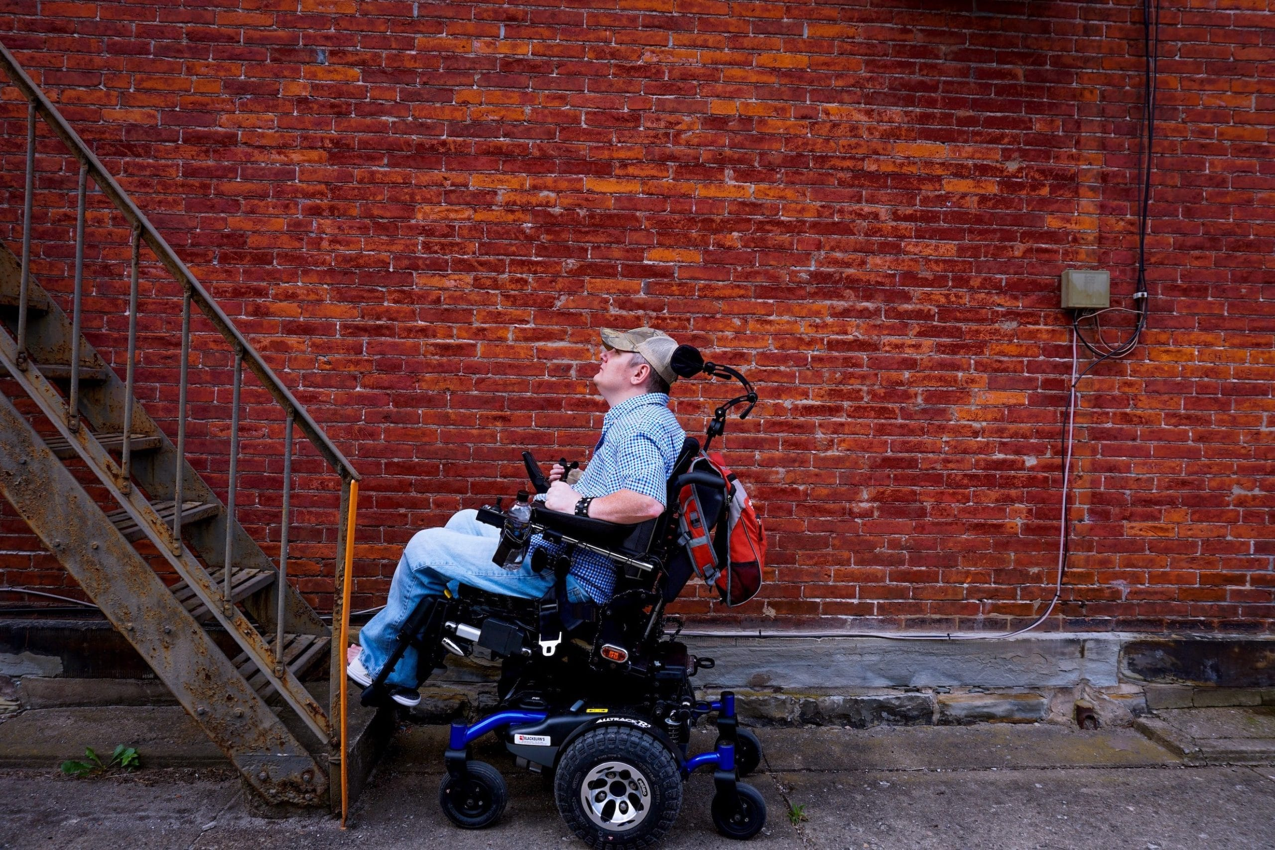 Tim Taylor faces a set of stairs in his power wheelchair.