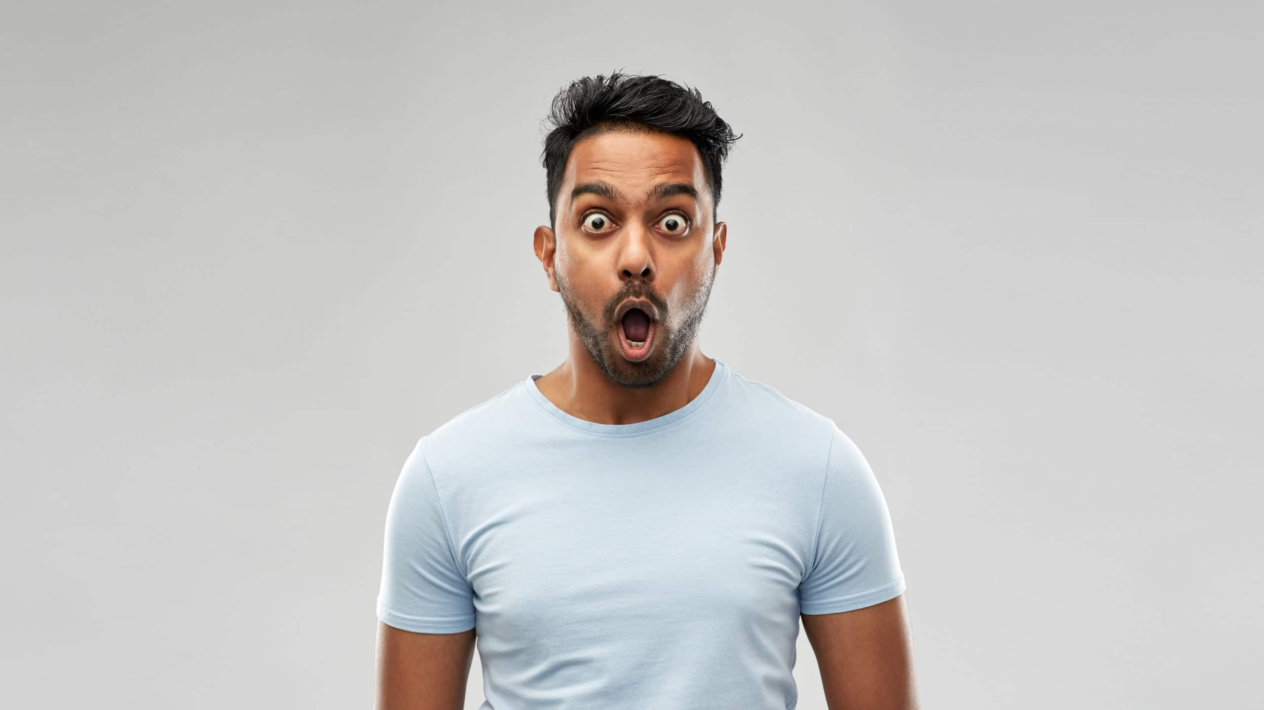 Man stares with a shocked look and open mouth.
