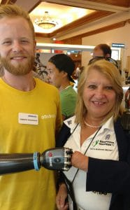 A man from Ottobock with a bionic arm prosthetic and Gianna Rojas