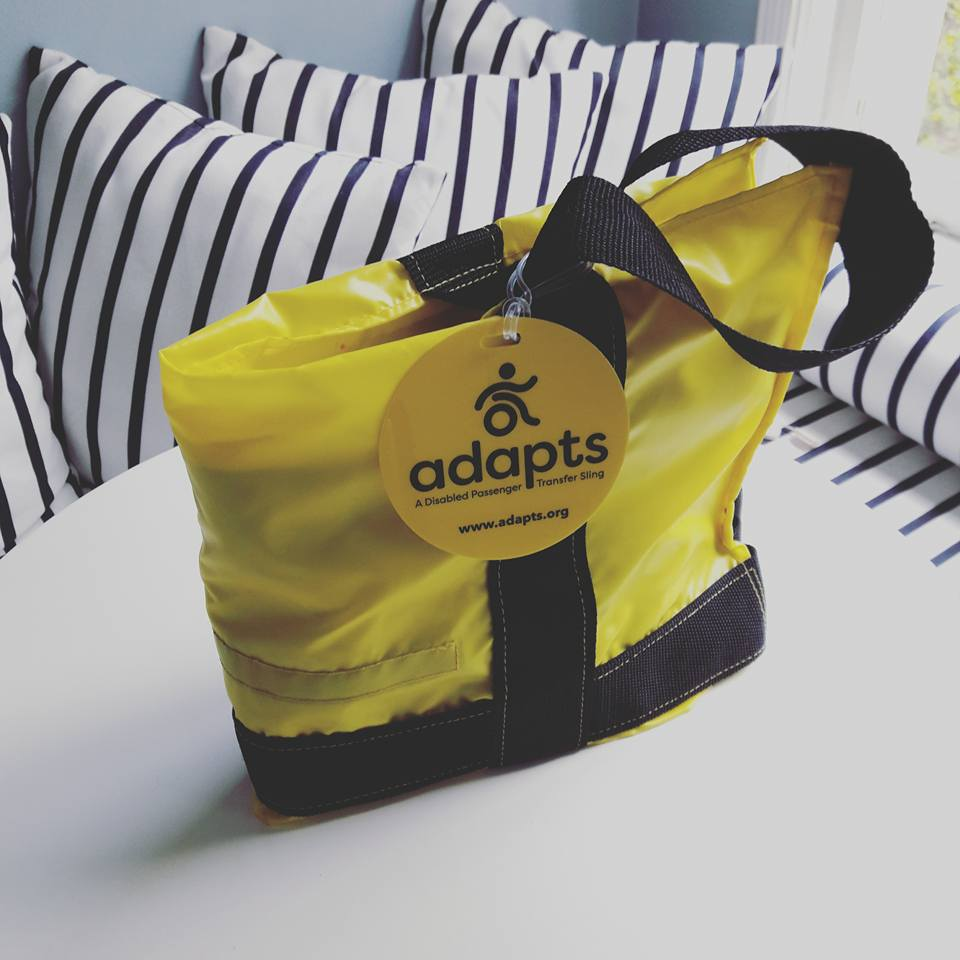 ADAPTS folded into a portable yellow tote sitting on a table.