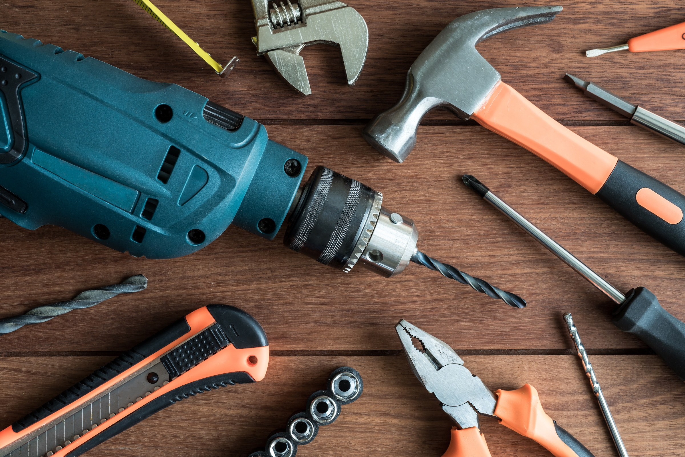 Top view of a set of work tools on wooden background