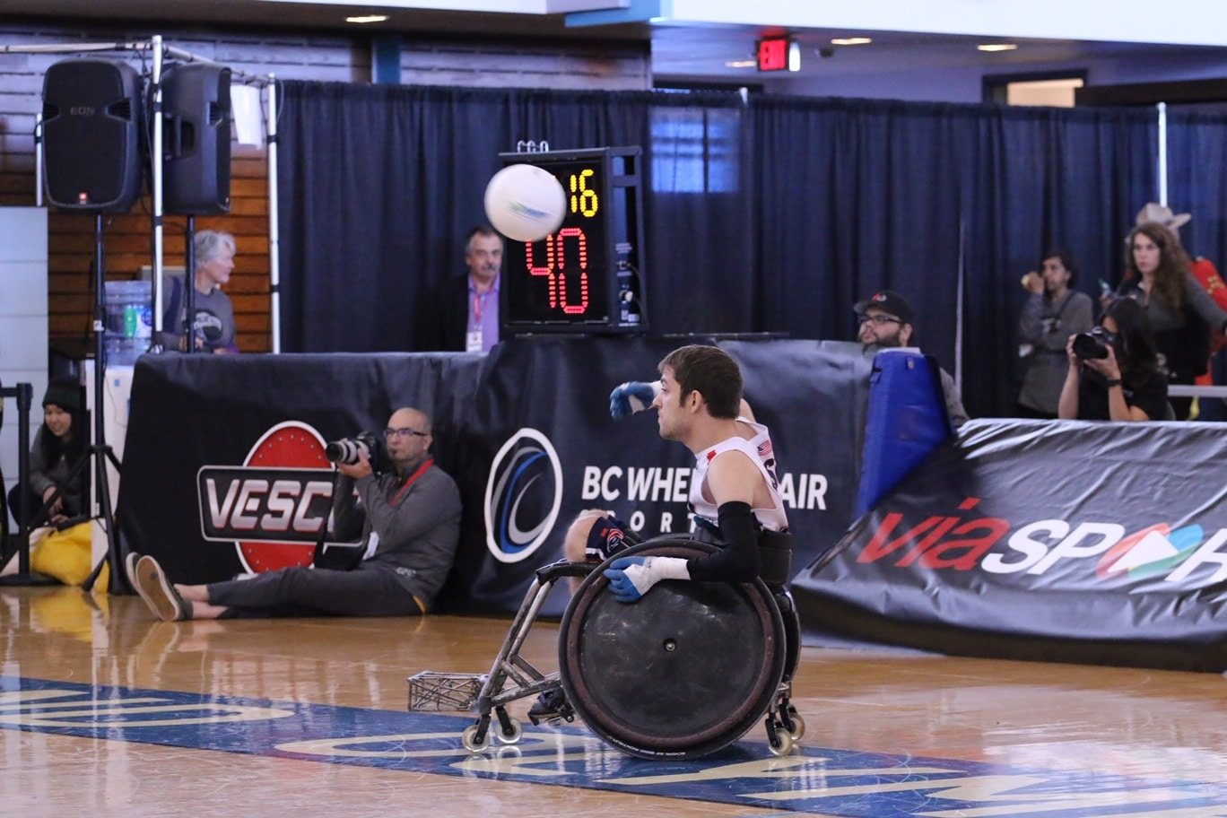 Jeff Butler throws the ball from his wheelchair while playing wheelchair rugby.