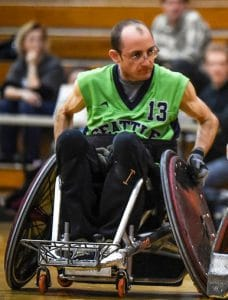 Jayden in his rugby wheelchair wearing a bright green jersey.